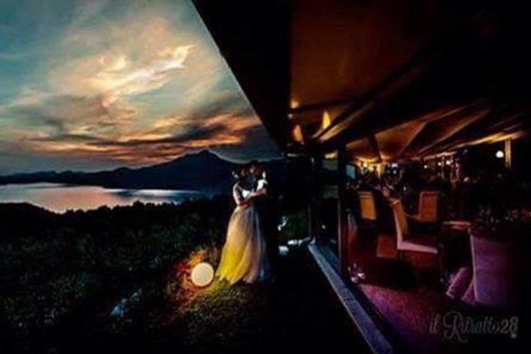 A couple enjoying evening views at Casa Degli Spiriti, Lake Garda