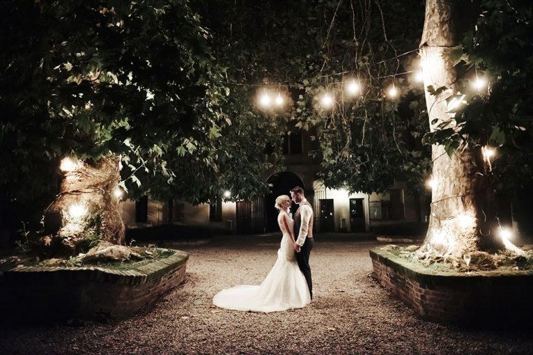 The Bride and Groom in the courtyard of Villa Tassanara, Lake Garda
