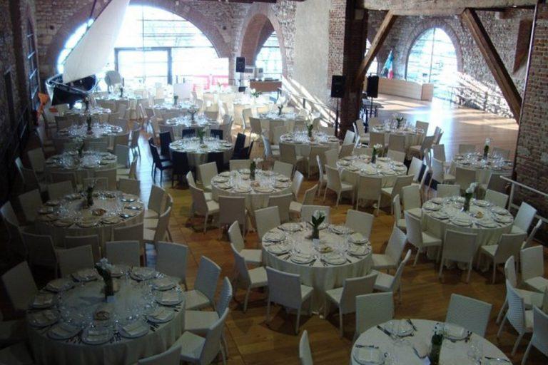 Inside Dogana Veneta, tables laid for a Wedding Reception