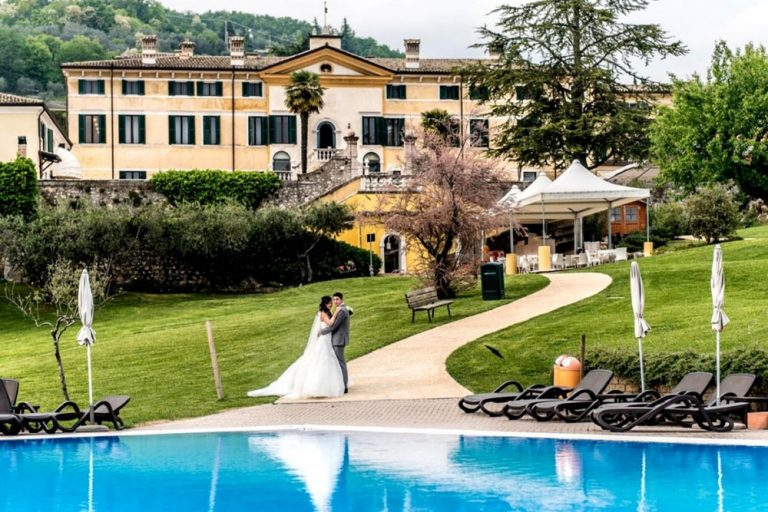 The Bride and Groom beside the pool at Villa Cariola, Lake Garda, Italy