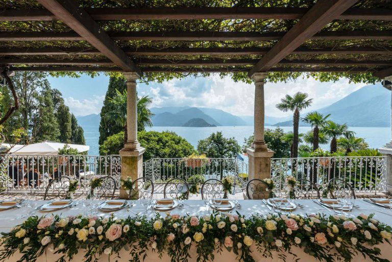View from a table covered in wedding flowers at Villa Cipressi